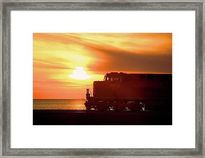Train And Sunset Framed Print by Paul Kloschinsky