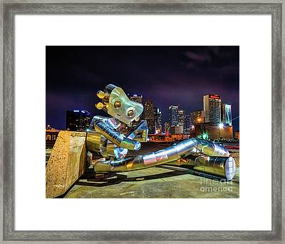 Traveling Man Takes A Break Framed Print by Tod and Cynthia Grubbs