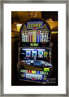 Triple Lucky 7s Slot Machine At Lumiere Place Casino Framed Print by David Oppenheimer