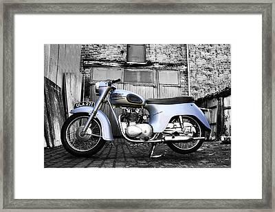 Triumph Twenty One Framed Print by Mark Rogan