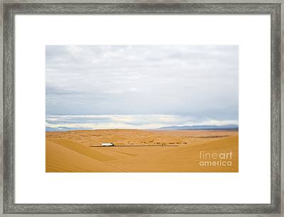 Truck Driving Through Desert Framed Print