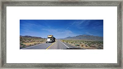 Truck On A Highway Viewed Framed Print by Panoramic Images