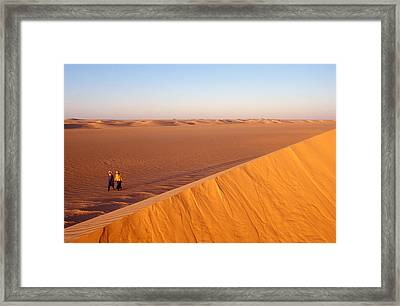 Tuaregs Catch Up To Their Camel Caravan Framed Print by Michael S. Lewis