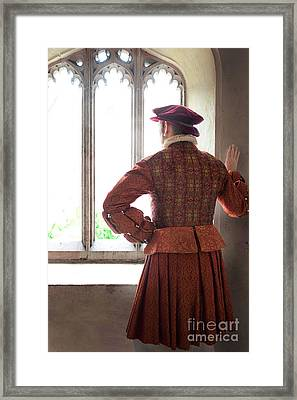 Tudor Man At The Window Framed Print by Lee Avison