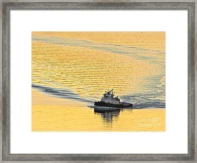 Tugboat At Sunset Framed Print