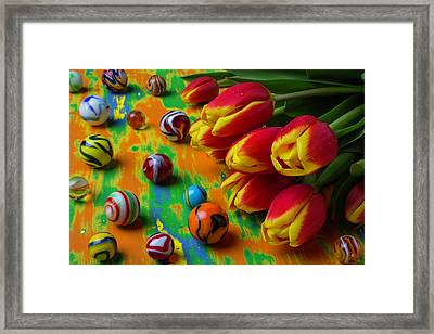 Tulips And Marbles Framed Print