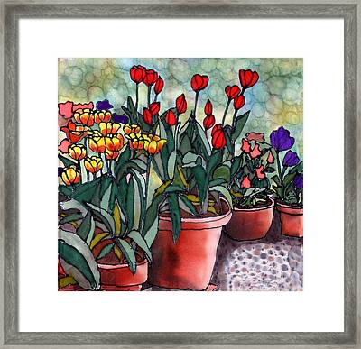 Tulips In Clay Pots Framed Print by Linda Marcille