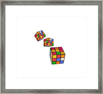 Tumbling Cubes Framed Print