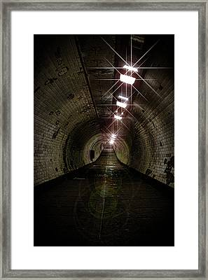 Tunnel Light Framed Print by Martin Newman