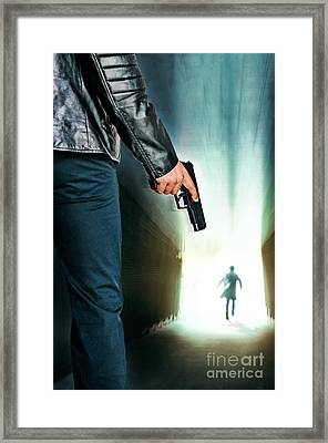 Tunnel Pursuit Framed Print by Carlos Caetano