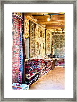Turkish Carpet Store Framed Print by Tom Gowanlock