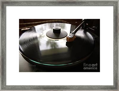 Turn Table Framed Print