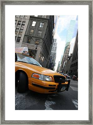 Turning Taxi Framed Print by Jeff Porter