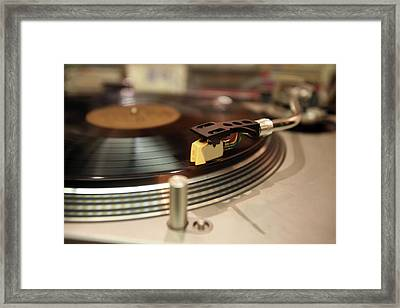 Turntable Framed Print by Gunter Nezhoda