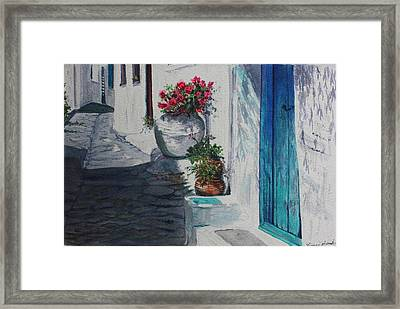 Turquoise Door Framed Print by Yvonne Ayoub