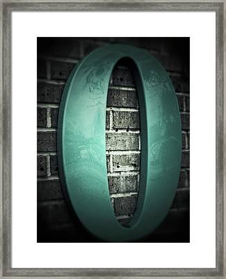 Turquoise Zero On Gray Brick  Framed Print by Tony Grider