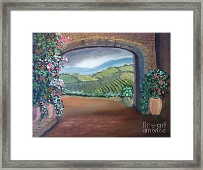 Tuscany Vineyards Through The Archway Framed Print