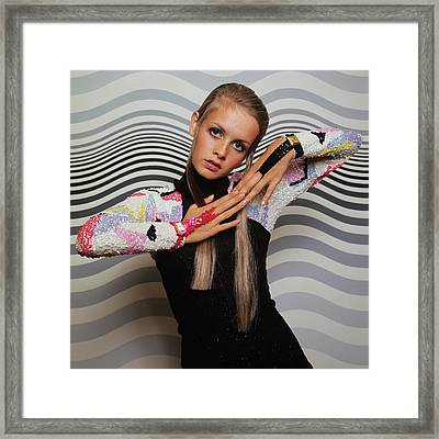 Twiggy Models In Front Of Waves Framed Print by Bert Stern