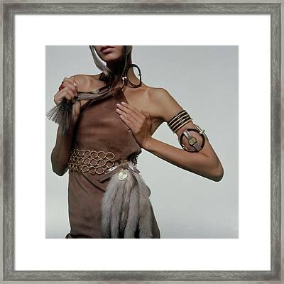 Twiggy Wearing Mink Tails Framed Print by Bert Stern