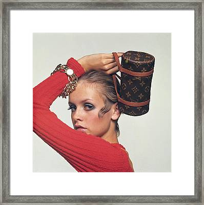 Twiggy With Louis Vuitton Purse Framed Print by Bert Stern