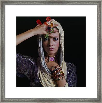 Twiggy With Lucite Rings Framed Print by Bert Stern