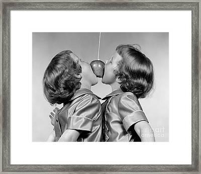 Twin Girls Bobbing For Apple Framed Print