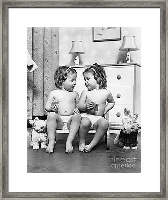 Twin Girls Sitting In A Double Seat Framed Print