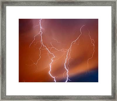 Twin Strike Framed Print