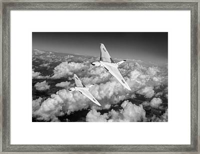 Framed Print featuring the photograph Two Avro Vulcan B1 Nuclear Bombers Bw Version by Gary Eason