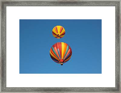 Two Balloons Passing Over Framed Print by Jeff Swan