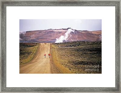 Two Bikers On A Dirt Road Leading To A Geothermal Power Station At Myvatn Framed Print by Sami Sarkis