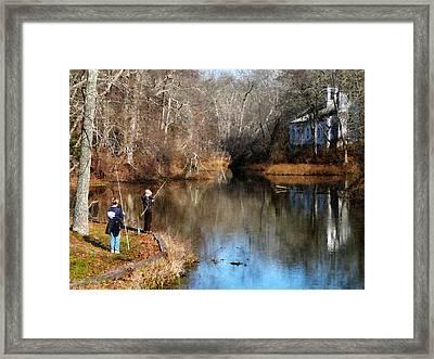 Two Boys Fishing Framed Print by Susan Savad