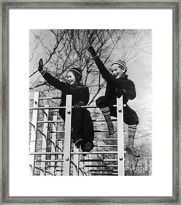 Two Children Waving From Play Framed Print