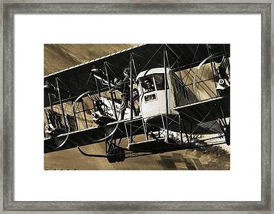 Two Crewmen Amid The Wires And Struts Of An Ilia Mourometz II Bomber Framed Print by Wilf Hardy