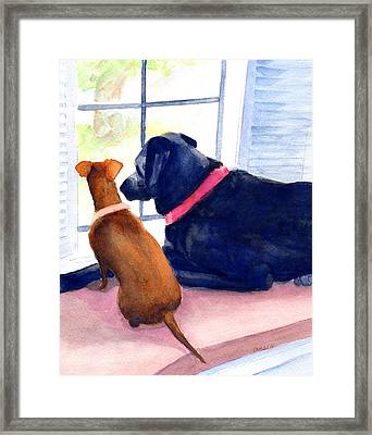 Two Dogs Looking Out A Window Framed Print