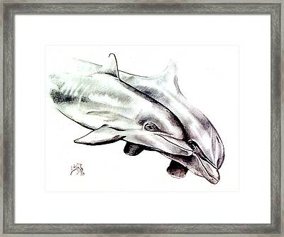 Two Dolphins Framed Print by John Keaton