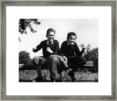 Two Excited Boys On Fence, C.1930-40s Framed Print by H. Armstrong Roberts/ClassicStock