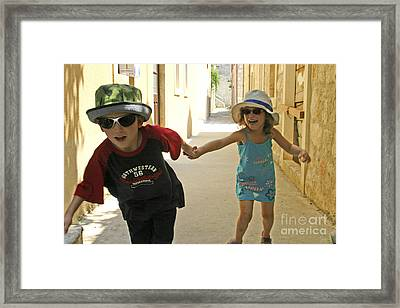 Two Excited Children Framed Print by Danny Yanai