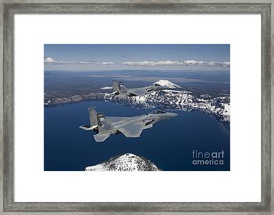 Two F-15 Eagles Fly Over Crater Lake Framed Print