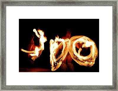 Two Fire Dancers Spinning Lit Batons At Night After A Luau Framed Print by Reimar Gaertner