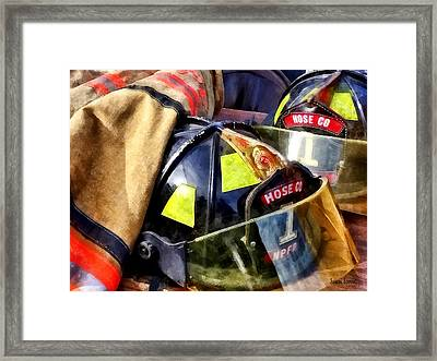 Two Fire Helmets And Fireman's Jacket Framed Print by Susan Savad