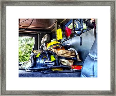 Two Firefighter's Helmets Inside Fire Truck Framed Print by Susan Savad