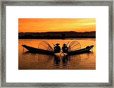 Framed Print featuring the photograph Two Fisherman At Sunset by Pradeep Raja Prints