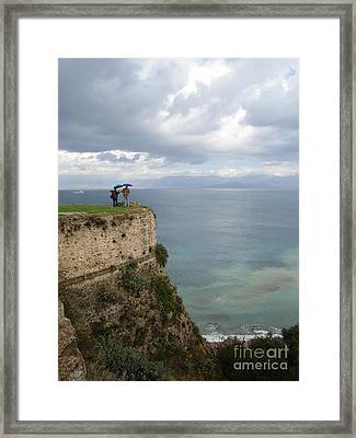 Two Friends Peer Over A Cliff And See The Horizon Framed Print by Clay Cofer