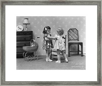 Two Girls Playing With Dolls, C.1940s Framed Print by H. Armstrong Roberts/ClassicStock