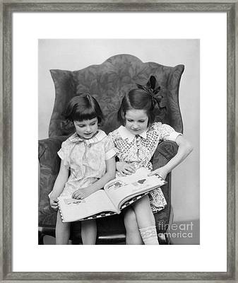 Two Girls Reading A Book, C.1920-30s Framed Print