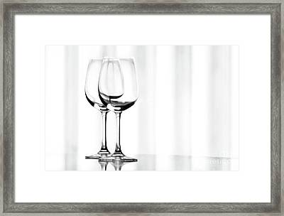 Two Glasses Framed Print by Dan Holm