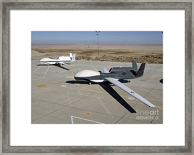 Two Global Hawks Parked On A Ramp Framed Print by Stocktrek Images