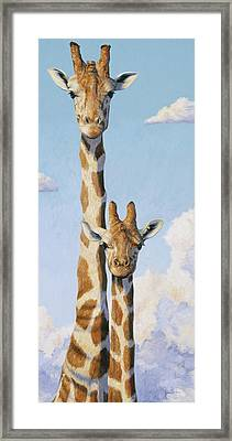 Two Heads In The Clouds Framed Print by Lucie Bilodeau