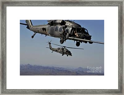 Two Hh-60 Pave Hawk Helicopters Prepare Framed Print by Stocktrek Images